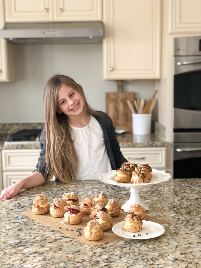 Girl standing with her Gluten free cheesecake puffs