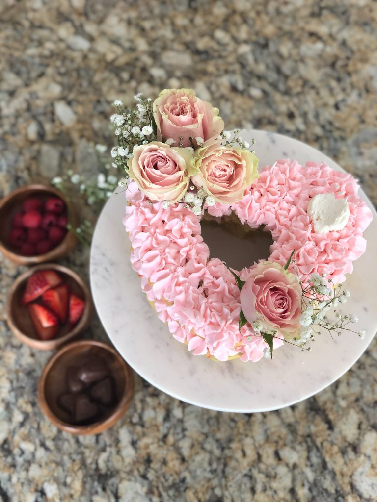 pink heart cake with flowers