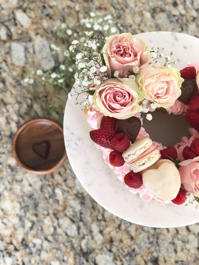 decorated pink heart shaped cake