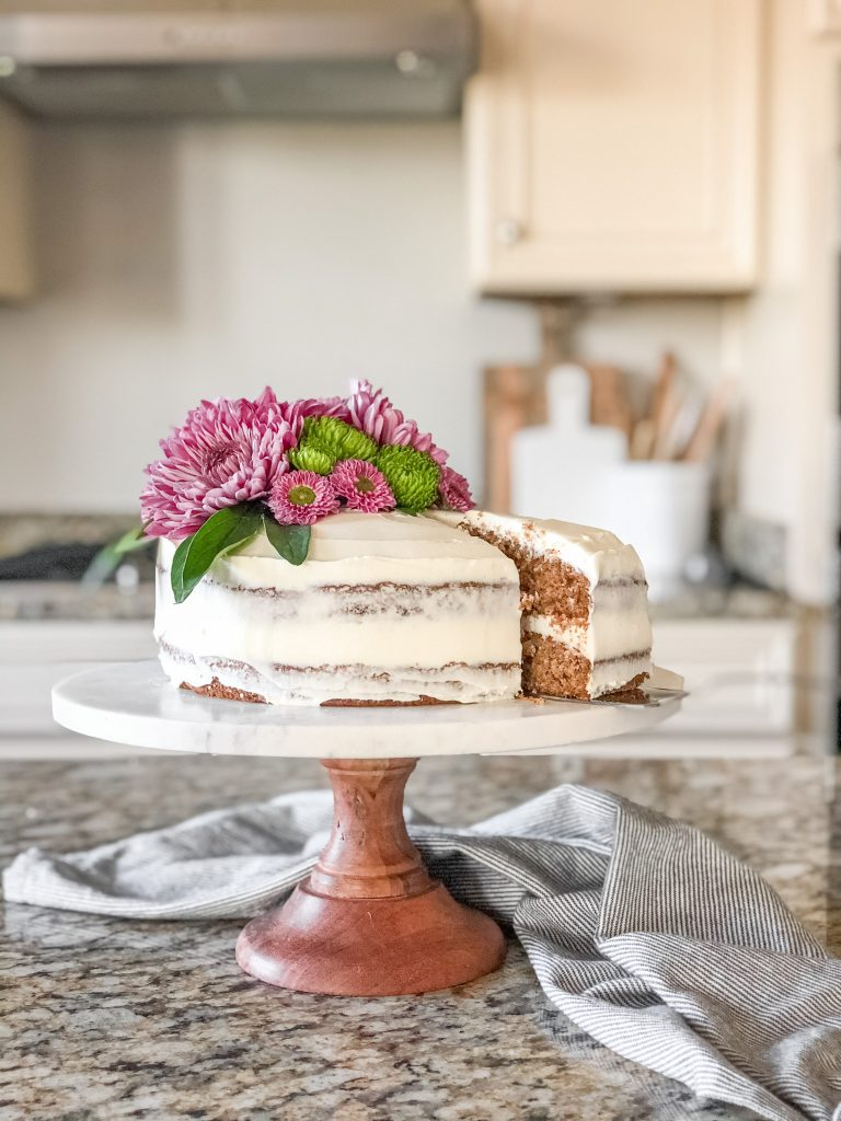 Serving Gluten free spice cake with cream cheese frosting