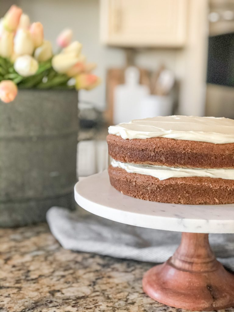 Frosting a gluten free spice cake
